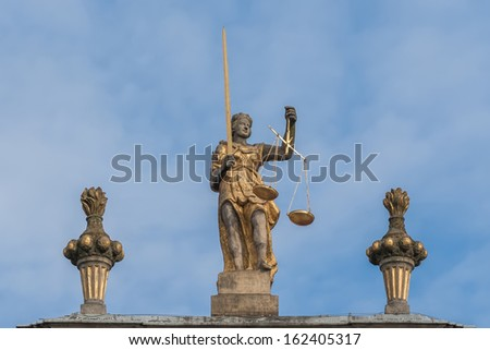 Sculpture of Themis with scales and sword. - stock photo