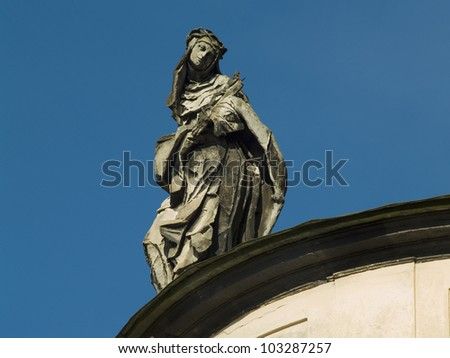 Sculpture of woman on Dominican Church. Lvov. Ukraine. - stock photo