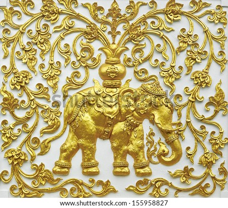 Sculpture on the temple wall in Thailand. - stock photo