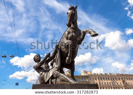 Sculpture tamer of horses, designed by the Russian sculptor Baron Peter Klodt.  Anichkov bridge, St. Petersburg, Russia, 1841 - stock photo