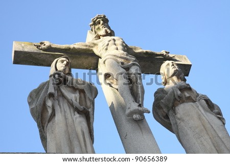 Sculpture witch Christ and two women - stock photo