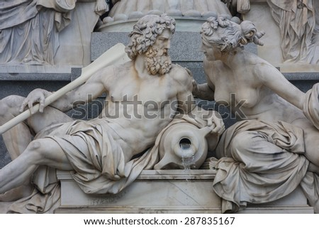 Sculptures representing Danube and Inn rivers at the foot of Athena figure in front of Parliament building in Vienna, Austria  - stock photo