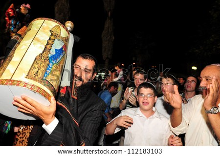 SDEROT - OCTOBER 14:Jewish people celebrate Simchat Torah on Oct 14 2006 in Sderot, Israel. Simchat Torah is a celebratory Jewish holiday marks the completion of the annual Torah reading cycle. - stock photo