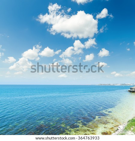 sea and blue sky with white clouds. Ukraine, Khersones in Sevastopol - stock photo