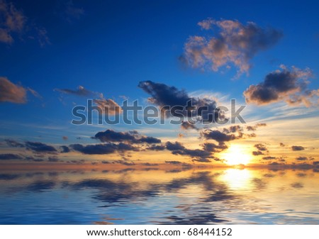 Sea and bright sky during sundown - stock photo