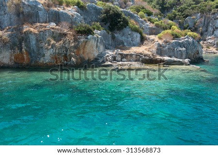 Sea and coast of island. Sea harbor with blue-green water and coast rocks. Beautiful seascape. Composition of nature. A lot of space for text. Tropical island.  - stock photo