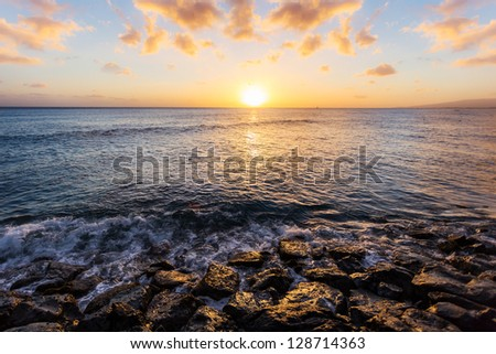 Sea and rock at sunset - stock photo