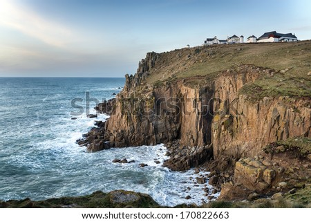 Sea and steep rugged cliffs at Lands End in Cornwall - stock photo