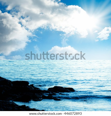 sea and waves over sunny sky - stock photo