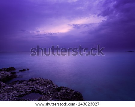 Sea at Night. Smooth Water Photo with  Long Exposure and Purple Filter. Copy Space. - stock photo
