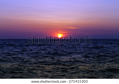Sea at sunset in summer - stock photo