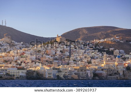 Sea bay near greek village at sunrise - stock photo