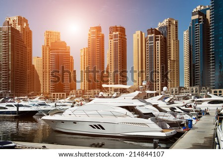 Sea bay with yachts at sunset in Dubai Marina - stock photo