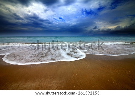 Sea beach and storm clouds. Wide angle view. - stock photo