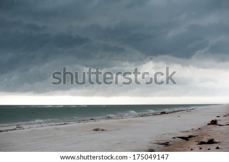 Sea beach before the storm: wind and clouds - stock photo