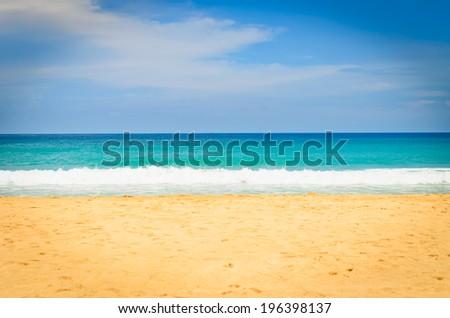 sea beach with blue sky background - stock photo