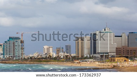 Sea coast and the view of the Tel Aviv from Old Jaffa - stock photo