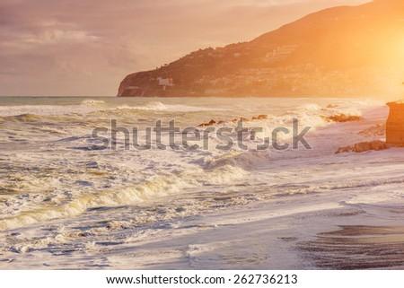 Sea coast at sunset - stock photo