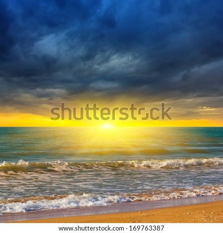 sea coast at the dramatic sunset - stock photo