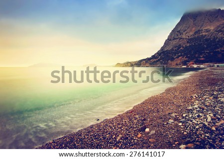 Sea coast in the evening. Color toning applied. - stock photo