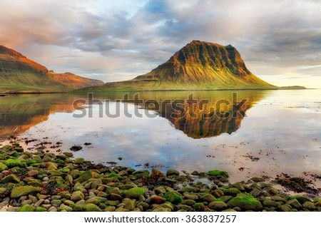 Sea coast with mountain reflection, Iceland - stock photo