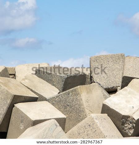 Sea dike with square blocks - stock photo