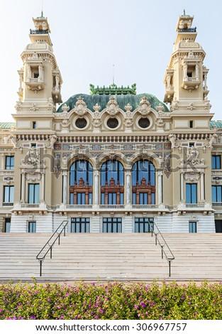 Sea facing facade of Monte Carlo casino building in Monaco viewed from gardens at seaside - stock photo