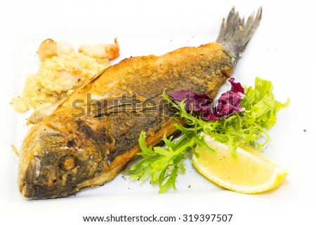sea fish cooked on the grill - stock photo