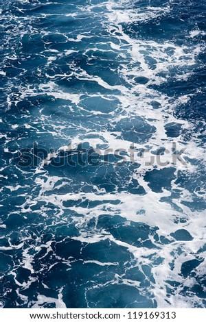 Sea foam and waves on the water of Adriatic Sea near Croatia. - stock photo