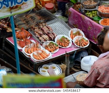 Sea food at Amphawa Floating Market near Bangkok, Thailand  - stock photo