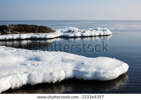 Sea ice, blocks of ice on the sea, winter sea and the ocean, Arctic aquatic nature, the ice floe in the ocean, melting ice, spring in the North sea, the Arctic in the spring, wildlife. - stock photo