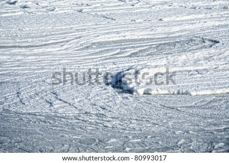 Sea ice swirling in the rough water of the Atlantic Ocean on the north shore of Prince Edward Island, Canada. - stock photo