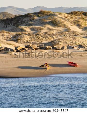 Sea kayak beach near the dune of Morro Bay - stock photo