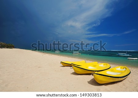 Sea kayaks on the beach,  Bali Indonesia - stock photo