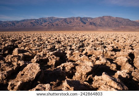 Sea Level Devil's Golf Course Death Valley Panamint Range - stock photo