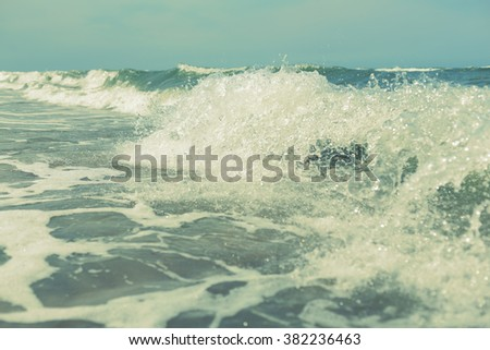 sea ocean water waves splash abstract background, filter, shallow depth of field - stock photo