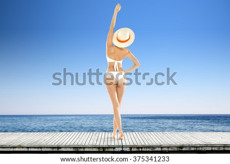 sea of blue color and sky with white bikini and free space  - stock photo