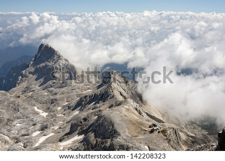 Sea of clouds as seen from the highest peak of Julian Alps  (Triglav 2864 m); Slovenia.  - stock photo