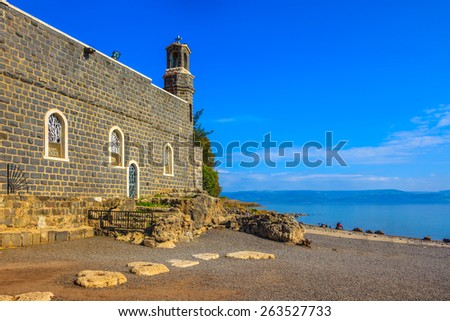 Sea of Galilee in Israel. The Church of the Primacy - Tabgha. The Holy Church was built on the Sea Gennesaret. Jesus then fed with bread and fish hungry people - stock photo