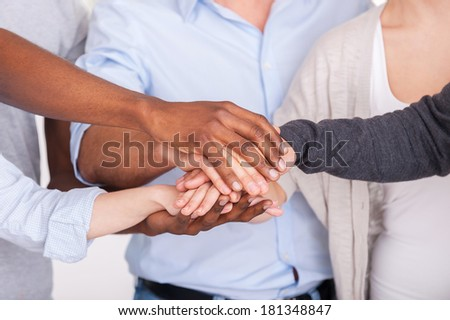 Sea of hands. Close up of people holding hands together  - stock photo