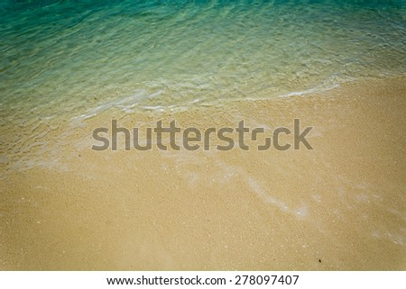 sea on the sand beach - vintage film filter - stock photo