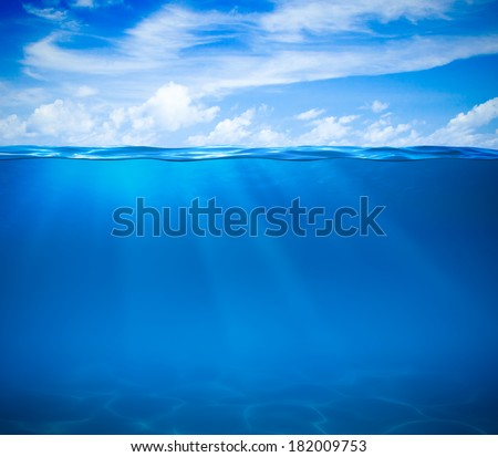 Sea or ocean water surface and underwater - stock photo