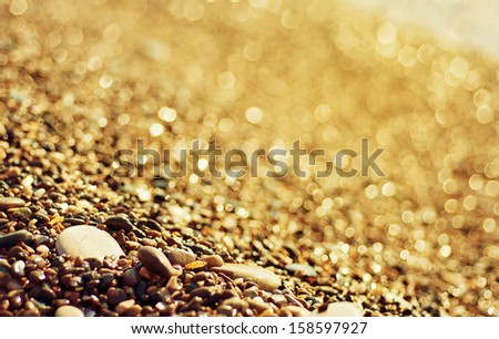 Sea pebble colorful golden  background, macro, shallow depth of field - stock photo
