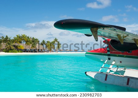 Sea plane at tropical beach resort - stock photo