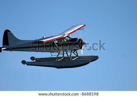 sea plane flying in the air - stock photo