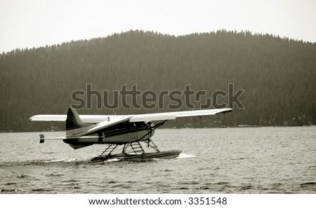 Sea plane taking off - stock photo