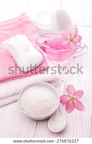 sea salt and essential oils, pink flower. spa - stock photo