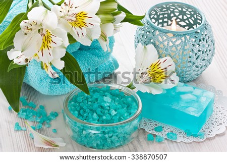 Sea salt, aroma candle, natural soap, soft towel and flower on wooden background/Aroma SPA set    - stock photo