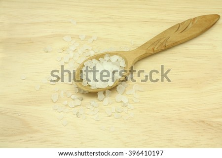 sea salt crystals in a wooden spoon texture - stock photo