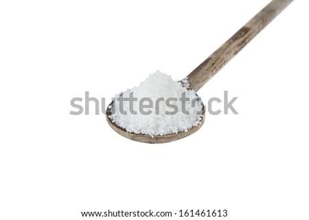 Sea Salt Fleur de Sel on wooden spoon isolated on white background - stock photo